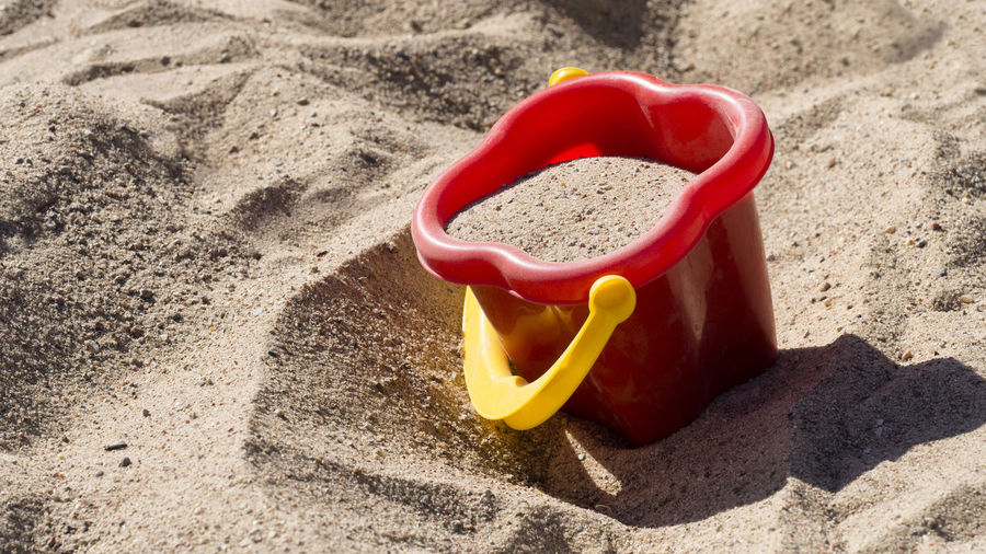 EyeEm Gallery Beach Bucket Childhood Close-up Container Day Nature Outdoors Personal Accessory Plastic Red Sand Sand Pail And Shovel Single Object Sunlight Toy