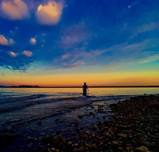Boy standing in the surf The Great Outdoors - 2016 EyeEm Awards The Essence Of Summer