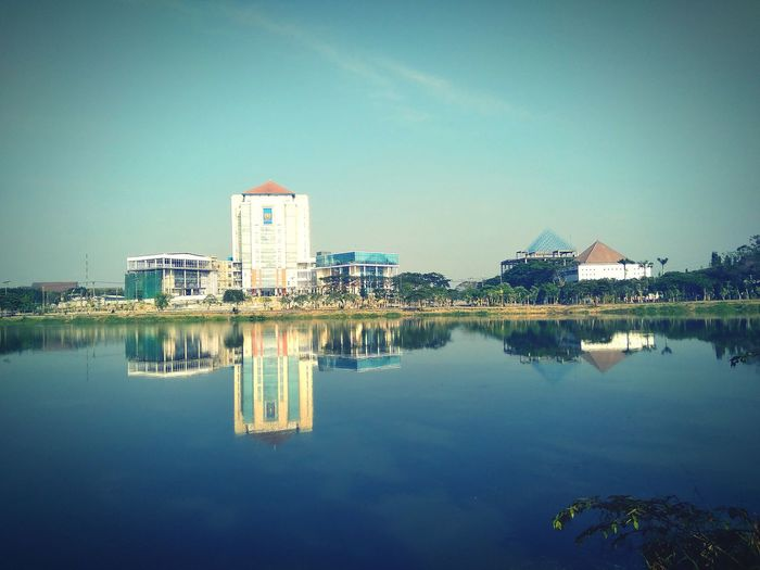 reflection of the building #gedung #gedungunesa #unesasby #building #buildings #building #sky #architecture #editoftheday City Water Cityscape Skyscraper Politics And Government Modern Symmetry Reflection Clear Sky Sky Standing Water Lakeside Waterfront Mid Distance Countryside Reflection Lake Lake
