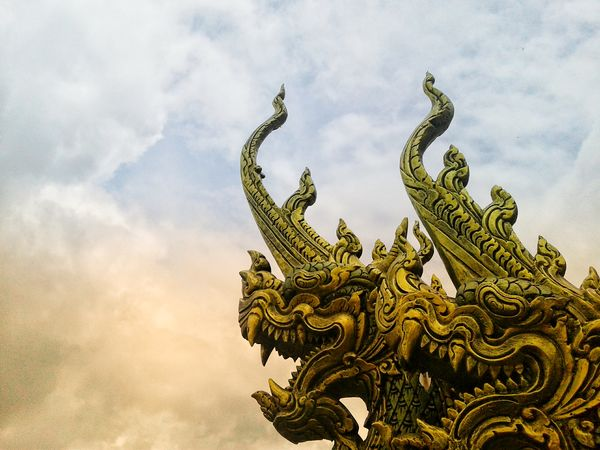 History Cultures Travel Thailand ThailandTemple Temple Temple Architecture EyeEmNewHere EyeEm Best Shots Eye4photography  Statue Religion Place Of Worship Sky Cloud - Sky Dragon Buddhist Temple Ancient Buddha Temple - Building Sculpture