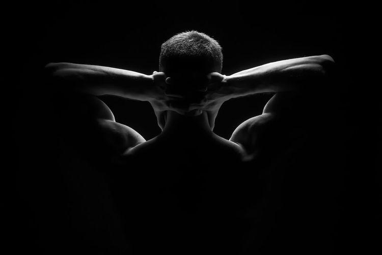 Black Background Studio Shot One Person Adult Hand Dark Indoors  Human Body Part Body Part Rear View Human Hand Emotion Shirtless Limb Human Limb Fear Waist Up Portrait Men Human Arm
