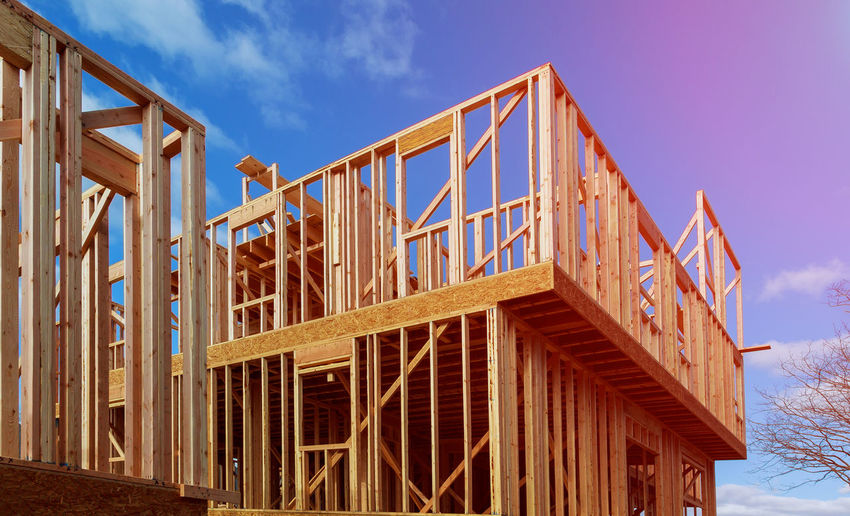 A stick built house under construction home framing Construction Construction Equipment Framing Home Industrial Renovation Roof Under Unfinished Work... Architecture Beams Build Building Built Structure Dwelling Frame Framework House House Construction Housing Lumber Plywood Reconstruction Residence Residential Building