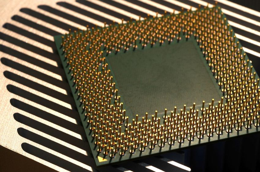 closeup of cpu processor on aluminum heat sink cooler CPU Futuristic Abstract Aluminum Amd Chip Circuit Circuit Board Close-up Computer Computer Chip Data Gold Colored Heatsink Integrated Circuit Intel Processor Cooler Processors Technology Transistor