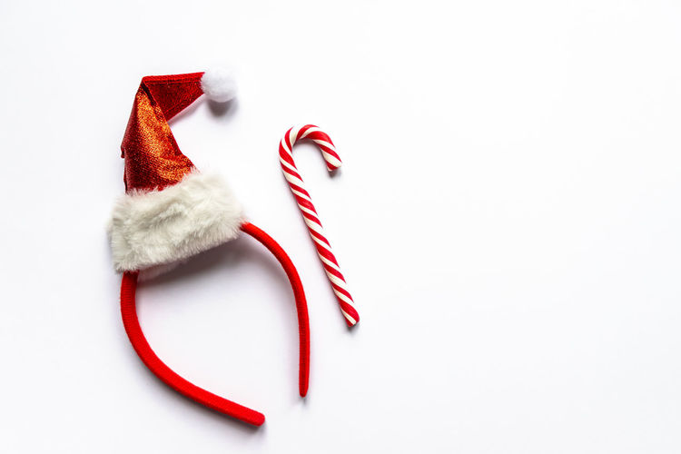 High angle view of christmas decorations over white background