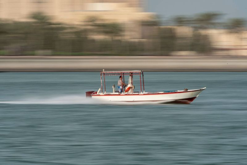 High speed boat Nautical Vessel Transportation Mode Of Transportation Water Motion Men Real People Waterfront Lifestyles on the move Sea