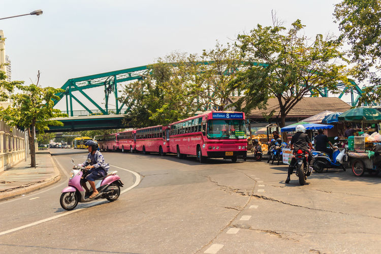 Bangkok, Thailand - March 2, 2017: Pink bus line number 8, starting point from the memorial bridge (Saphan Phut) to Happy Land, Minburi. Bus nummber 8 line is famous of fast and swiftly in Bangkok. Bus Trip Bus Terminal Station - Entrance Number 8 Pink Pink Bus Saphan Phut Adult Architecture Bus Bus Line Bus Terminal Bus Travel City Day Fast And Furious Fast And Furious 8 Fast And Swiftly Group Of People Happy Land Incidental People Land Vehicle Memorial Bridge Men Minburi Mode Of Transportation Motorcycle Nature Outdoors People Plant Real People Rickshaw Riding Road Sky Street Swiftly Transportation Tree