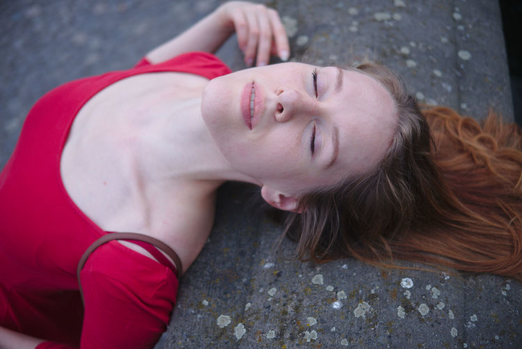 desire and passion with the model: Radmila Adult Beautiful Woman Day Eyes Closed  Hair Hairstyle High Angle View Leisure Activity Lifestyles Lying Down Lying On Back One Person Portrait Real People Red Relaxation Women Young Adult Young Women