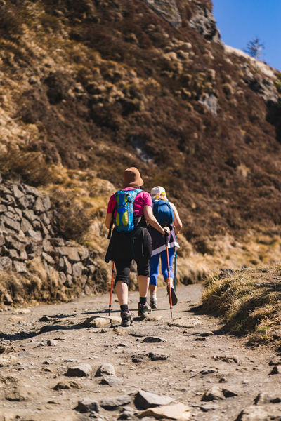 Two women hiking Hiking Travel Trekking Active Lifestyle  Activity Adventure Backpack Day Full Length Healthy Lifestyle Hiking Land Leisure Activity Lifestyles Mountain Nature Outdoors People Real People Rear View Rock Togetherness Two People Walking Women