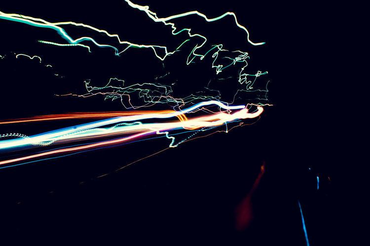 Light trails against black background