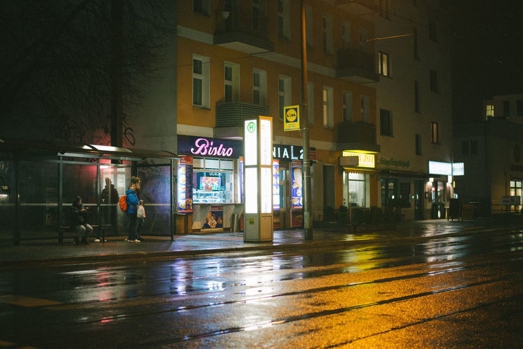 rainy nights. Berlin Illuminated City Architecture Night Building Exterior Street Built Structure Wet Communication Text Rain Transportation Road Sign Reflection City Life Outdoors Western Script City Street Rainy Season