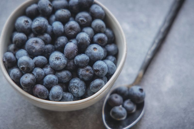 Blueberries Food And Drink Food Fruit Freshness Healthy Eating Bowl Berry Fruit Still Life Blueberry Indoors  No People High Angle View Table Close-up Directly Above Abundance