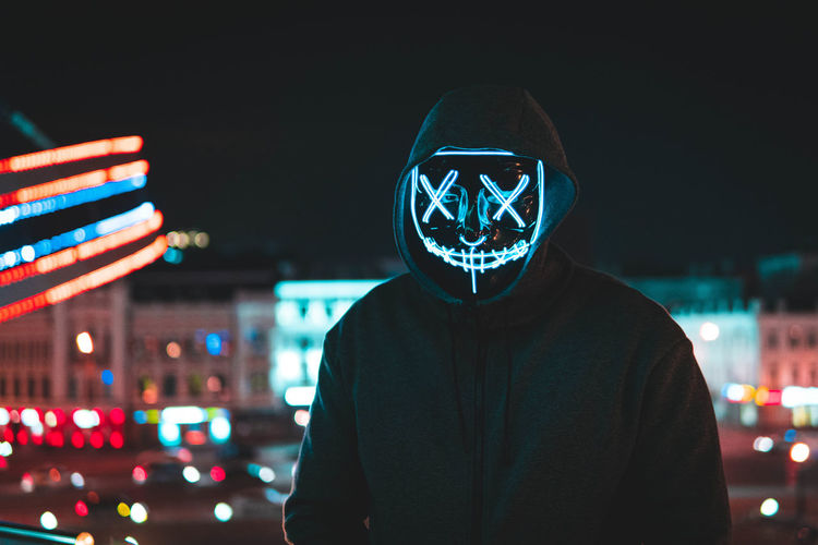 Night One Person Illuminated Real People Front View City Portrait Leisure Activity Men Lifestyles Waist Up Focus On Foreground Building Exterior Architecture Looking At Camera Hood Hooded Shirt Young Men Built Structure Hood - Clothing Obscured Face Portrait Photography Neon neon life Neon Colored Neon Photography