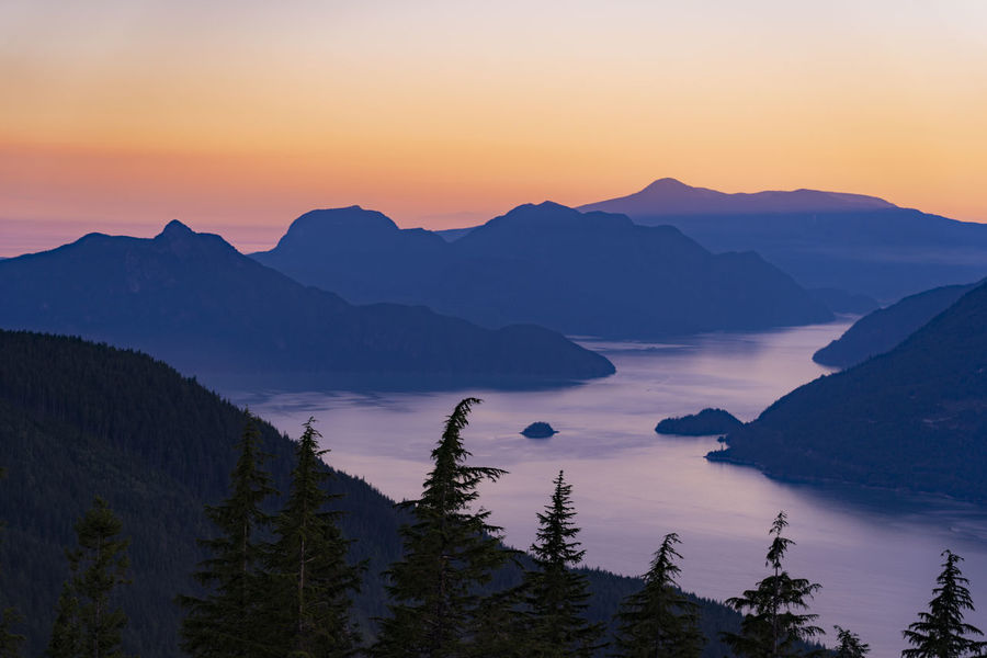 Inlet Orange Sky Alpenglow Dusk Fjord Hazy  Idyllic Mountain Mountain Peak Mountain Range Nature No People Ocean Orange Color Outdoors Plant Purple Sky Sea Silhouette Sky Sunset Tranquility Tree Warm Water