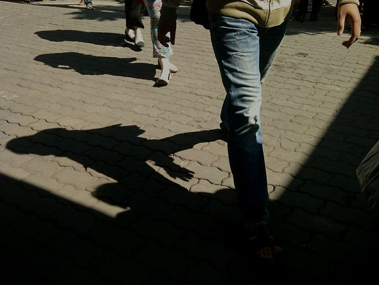 Walking Shadow Outdoors Streetphotography Street Public Places INDONESIA Indonesian Street Photography EyeEm The Streets Maklumfoto The Week Of Eyeem The Week On Eyem EyeEm Indonesia Street Photography EyeEm Best Shots - The Streets