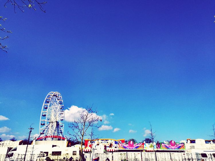 Ferris Wheel Amusement Park Arts Culture And Entertainment Blue Rollercoaster Amusement Park Ride Sky No People Outdoors Day Tourism From Where I Stand Light Up Your Life City Vacations Light Modern Travel EyeEmNewHere