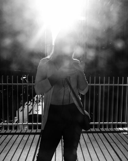 Scenes from the #l #cta #chicago #blackandwhitephotography #streetphotography #train Blackandwhite Glare Silhouette Streetphotography Chicago Real People One Person Sunlight Standing Railing Adult