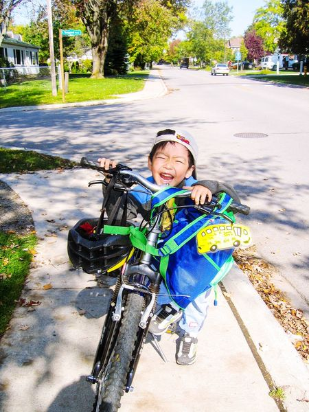 Happy kid Kindergarten Cute Smile Happy Neighborhood Schoolboy Bicycle Childhood Child Full Length Portrait Sunlight Real People Boys Innocence Looking At Camera
