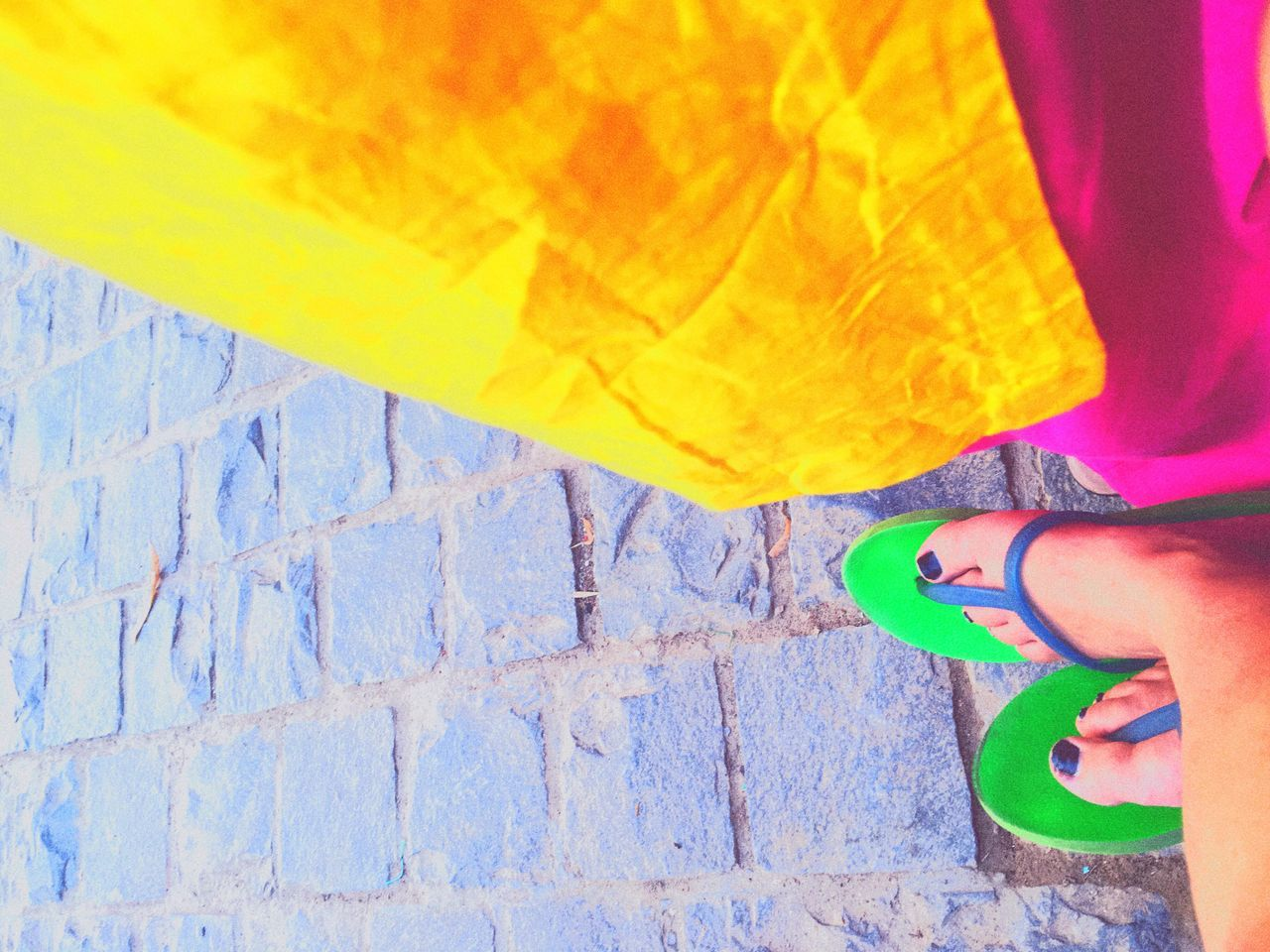 human body part, human leg, real people, low section, body part, one person, standing, lifestyles, shoe, high angle view, women, leisure activity, adult, day, yellow, multi colored, unrecognizable person, outdoors, human foot, jeans, human limb