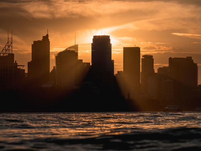 Sunset beams epic rays across the Sydney Skyline. Australian Landscape Sunset_collection Sydney, Australia Architecture Building Exterior Built Structure City Cityscape Day Downtown District Modern Nature No People Outdoors Silhouette Sky Skyscraper Sunlight Sunset Sydney Travel Destinations Urban Skyline Water Waterfront Week On Eyeem Go Higher