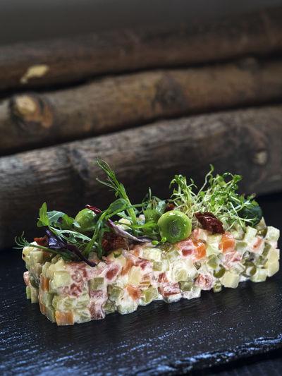 Close-up of olivier salad on slate