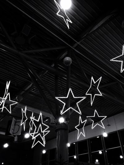 Stars at the airport in black and white Athens Airport Airport Photography Airport Waiting Black And White Photography Christmas Decor Stars Airport Low Angle View Ceiling Illuminated Night Indoors  No People Hanging First Eyeem Photo