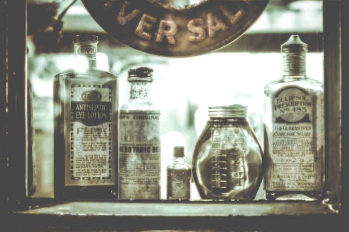 at the Bygones Museum, Torquay BYGONES MUSEUM Medicene Old Fashioned PHARMACY WINDOW Pharmacy Victorian Bottle Bottles Bottles Collection Bygones Close-up Day Edwardian Indoors  Jar Lotions Museum No People Pharmaceutical Potion Retail  Retail Display Shop Shop Window Yesteryear
