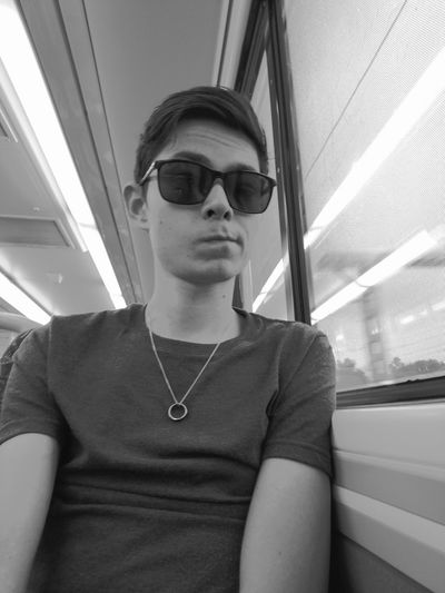 Pondering the world we live in. Sunglasses Young Adult One Person Outdoors People Day Tourism City Life Travel Exploring Scenics Train Window