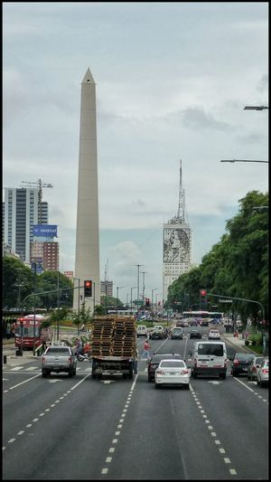 The Obelisk and the portrait of Evita Peron on July 9th Avenue, Buenos Aires, Argentina. Obelisk Obelisco, Buenos Aires 🌆 Taking Photos Buenosaires Architecture_collection Architecturephotography Travel Argentina Photography Argentina Buenos Aires Eye4photography  Cars Traffic Travelphotography Urbanphotography Sony Street Photography Evita Peron Urban Architecture Architecture EyeEm Car Urban Photography Streetphoto_color Streetphotography