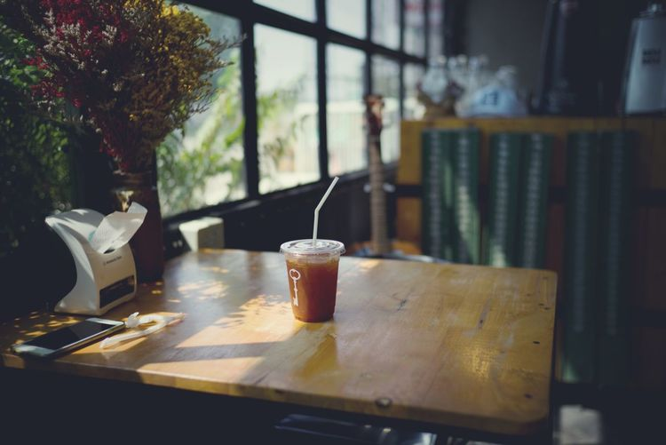 Iced Americano black coffee on a wooden table Coffee Shop Coffee Leica Morning Ice Americano Table Food And Drink Indoors  No People Window Still Life Drink Close-up Glass - Material Wood - Material Cafe Mug Restaurant Cup Nature Freshness