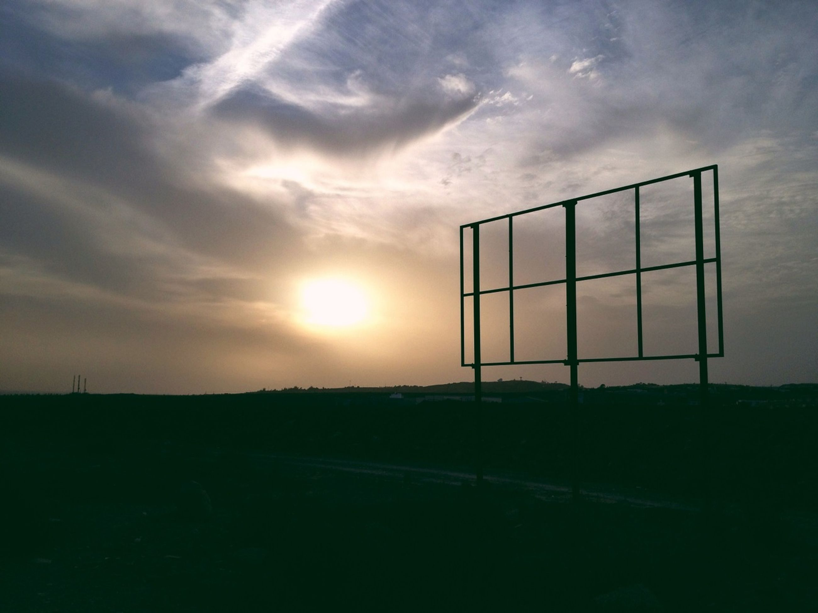 sunset, sky, sun, cloud - sky, sunlight, landscape, cloud, silhouette, field, sunbeam, nature, scenics, tranquil scene, tranquility, lens flare, beauty in nature, cloudy, fence, built structure, outdoors