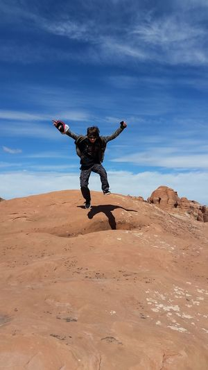 Exuberance One Person Skyjump Outdoors Moab  Rock Formation Jump For Joy Live For The Story