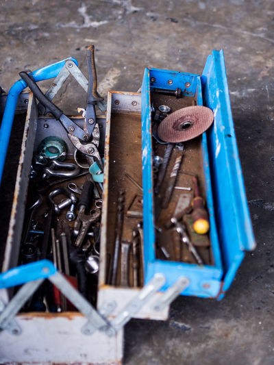 High angle view of work tools in box at workshop