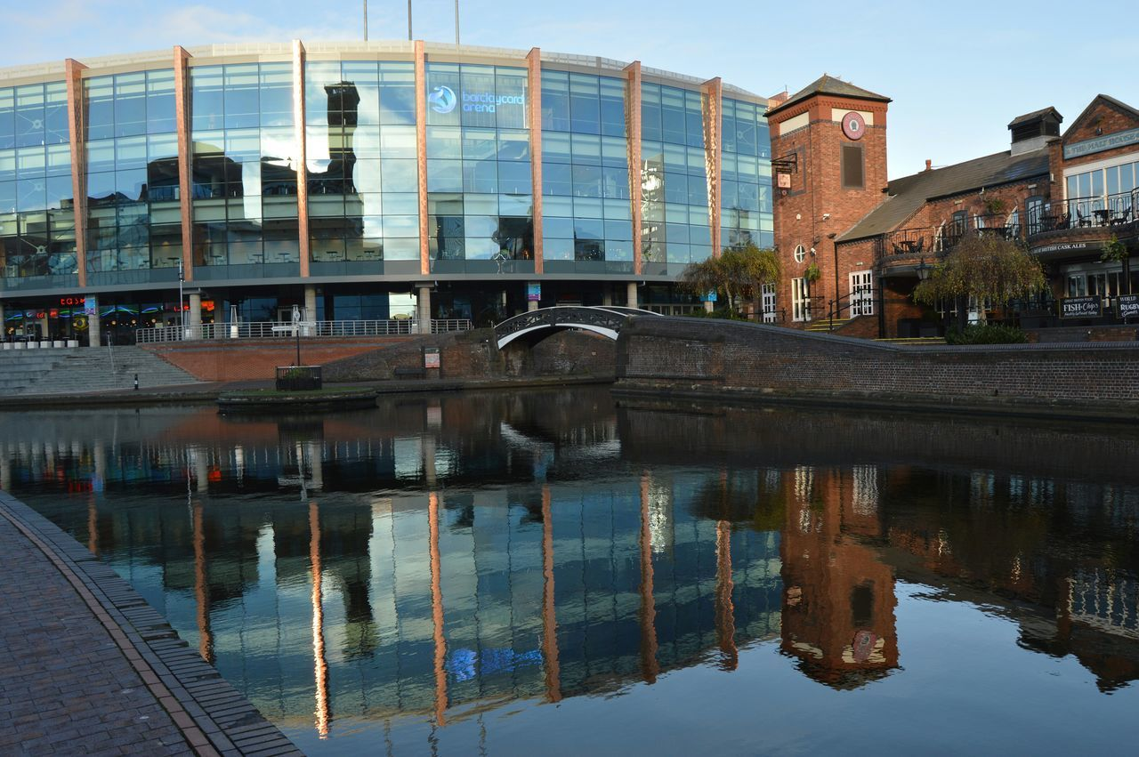 architecture, built structure, reflection, building exterior, water, outdoors, reflecting pool, no people, sky, day, city