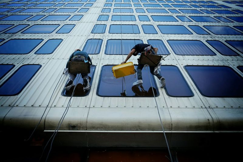 Low angle view of woman standing in building