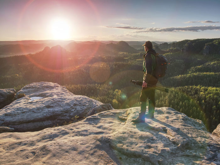 Man standing on mountain against sky
