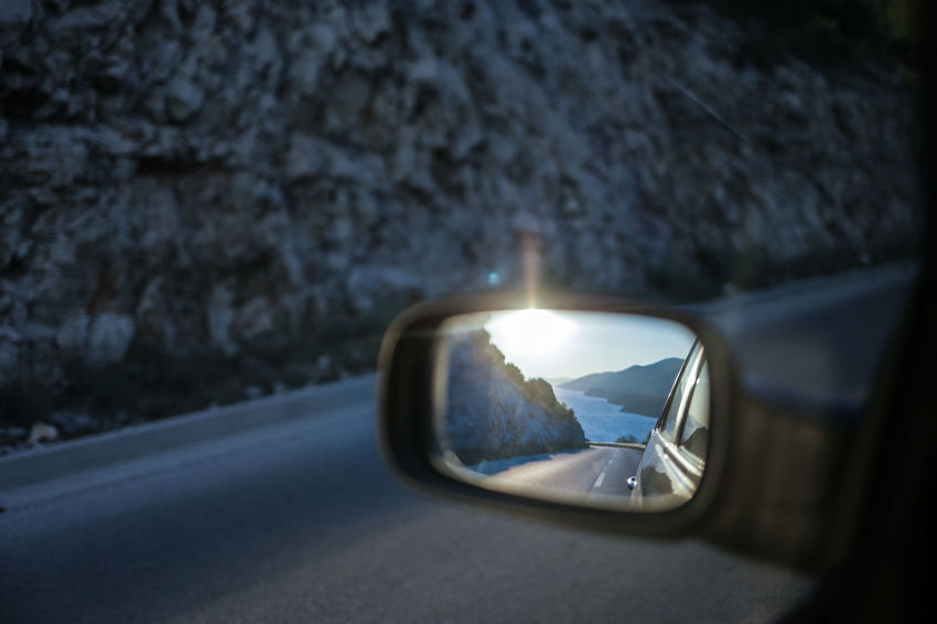 On the road at Peljesac peninsula in Southern Dalmatia, Croatia Adriatic Car Close-up Croatia Dalmatia Day Driving Journey Land Vehicle Mode Of Transport Mountains Nature No People Outdoors Peljesac Reflection The Great Outdoors - 2017 EyeEm Awards Road Road Trip Side-view Mirror Sunset The Drive Transportation Travel Photography Vehicle Mirror