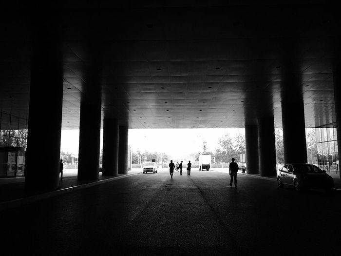 Silhouette People Walking Road Below Bridge
