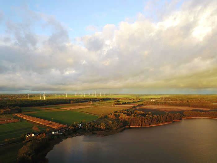 Rehfelde Grünheide Lake Wind Power Wind Turbine Sky Cloud - Sky Water Scenics Nature No People Beauty In Nature Sea Tranquility Architecture Outdoors Day Landscape Built Structure Building Exterior