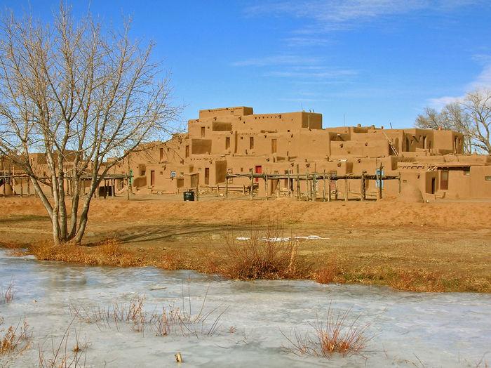 Taos Pueblo during winter. New Mexico Taos Pueblo Native American Scenics
