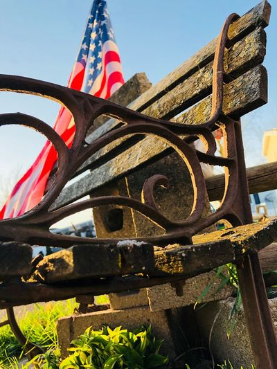 Old bench Day No People Nature Sky Sunlight Architecture Outdoors Metal Plant Built Structure Belief Spirituality Close-up Low Angle View Flag Clear Sky Striped