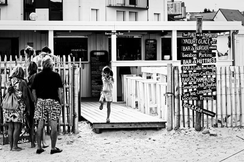 La Plage Wissant- Great place to have a drink or grab a bite right on the sand Nikon Family Black And White Photography Black & White Black And White Côte D'Opale Opale Coast France Plage Wissant Beach Sand Drink Building Exterior Built Structure Real People Architecture Outdoors Men Day Women Lifestyles Standing People