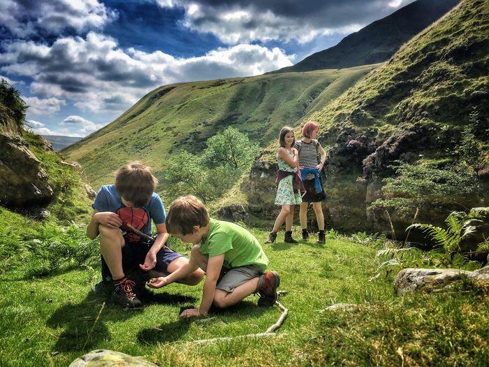 Siblings On Grassy Field At Howgill Fells
