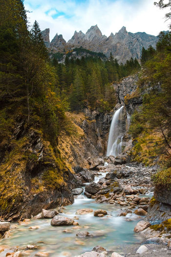 Waterfall in the wildernes Water Scenics - Nature Waterfall Beauty In Nature Tree Mountain Rock Flowing Water Nature Long Exposure Sky Forest Environment No People Solid Rock - Object Blurred Motion Flowing Outdoors Power In Nature Stream - Flowing Water Nikon Nikonphotography Switzerland Landscape