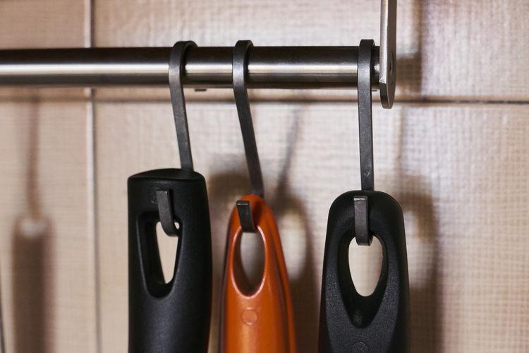 Close-Up Of Kitchen Utensils Hanging In Kitchen