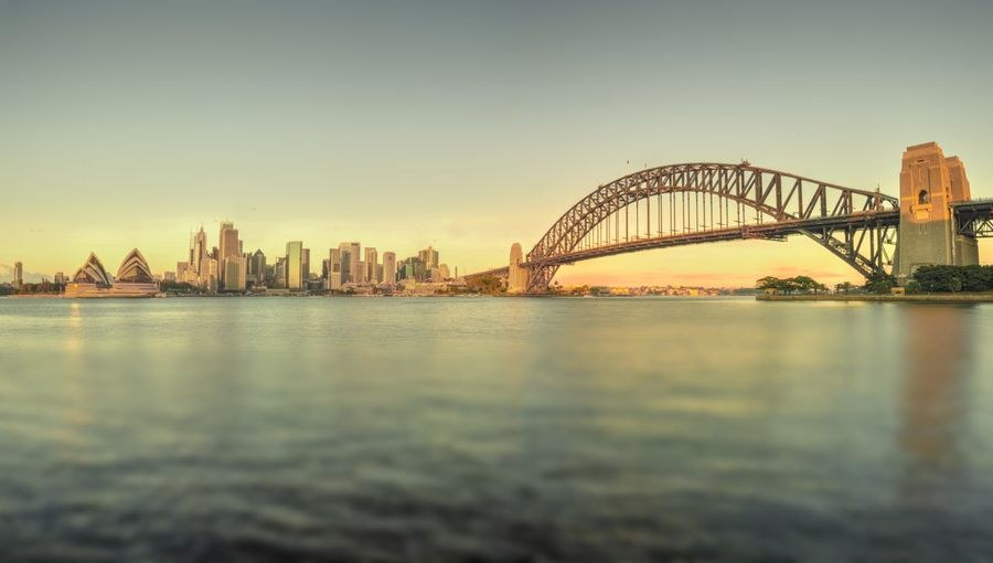 Sunrise at Sydney Harbor Sydney Harbour Bridge Sydney Opera House Sydney Harbour  Arch Bridge Architecture Bay Bridge Bridge - Man Made Structure Building Exterior Built Structure City Cityscape Connection Financial District  Nature Outdoors Sky Skyscraper Sunrise Sunrise_sunsets_aroundworld Transportation Travel Destinations Urban Skyline Water Waterfront