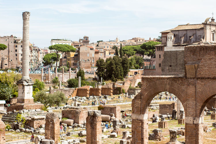 Old ruins at roman forum against sky