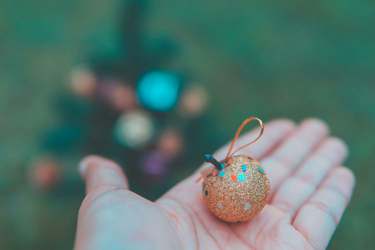 Close-up of hand holding christmas decoration
