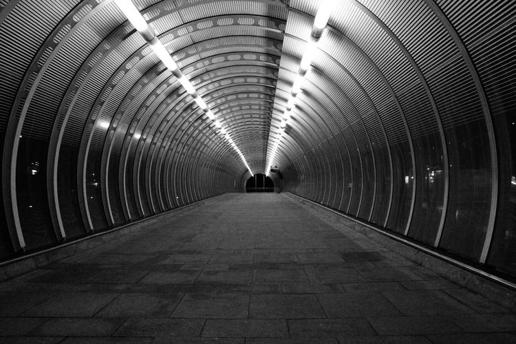 Illuminated Architecture Built Structure The Way Forward Subway Station Subway Indoors  Arch Tunnel Real People Underpass Day London Canary Wharf