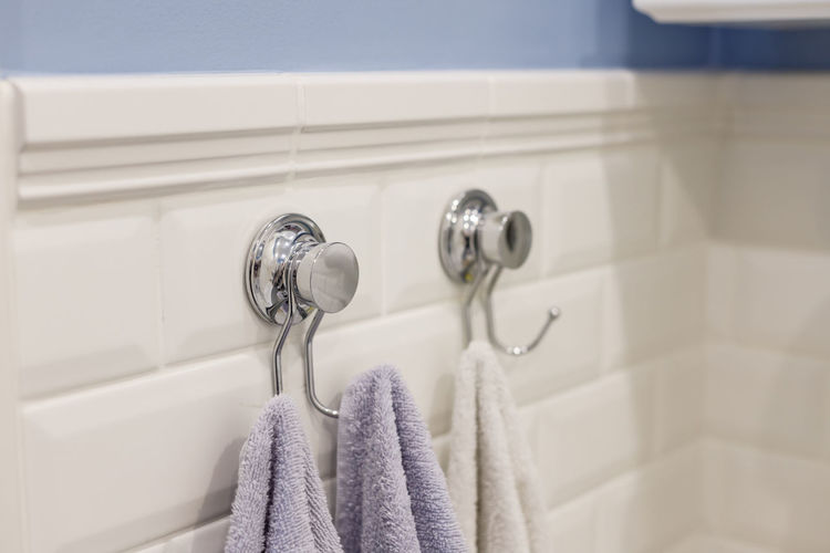 Close-up of towel hanging at bathroom
