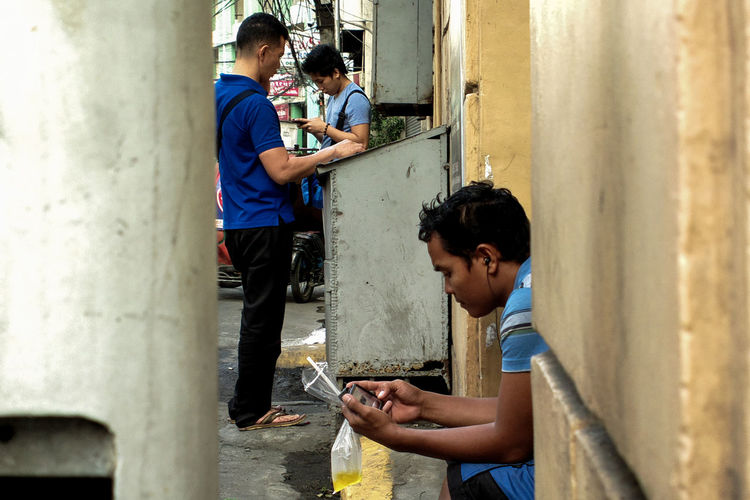 Wireless Technology Communication Casual Clothing Togetherness Young Adult Connection Real People Business Finance And Industry Portable Information Device Men Indoors  People Adult Adults Only Only Men Day Street Photography Nokia808Pureview NbanFamily Manila, Philippines Eyeem Philippines